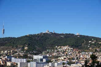 view of a church on a hill + an amusement park (from Park Güell)