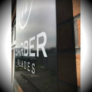 External tray sign powder coated black with silver vinyl cut lettering for Barber Blades warehouse, Cardiff