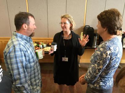 Health department director Joanna Fuller with two participants.