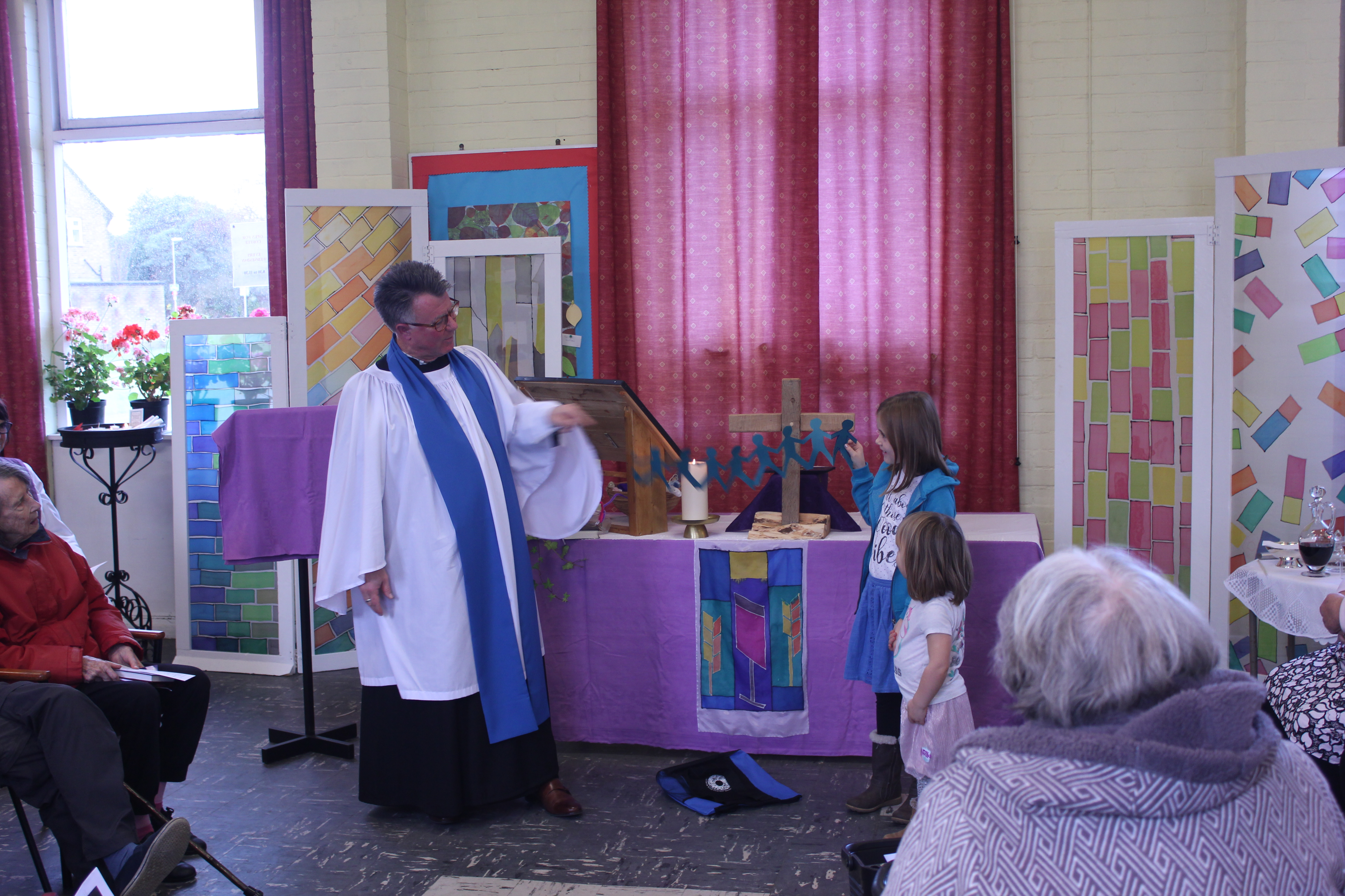 Holly and Ava helping Steve Sakakini with his sermon