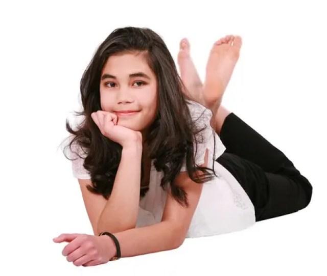 Beautiful Biracial Teen Girl Lying On Floor Relaxing Stock Photo