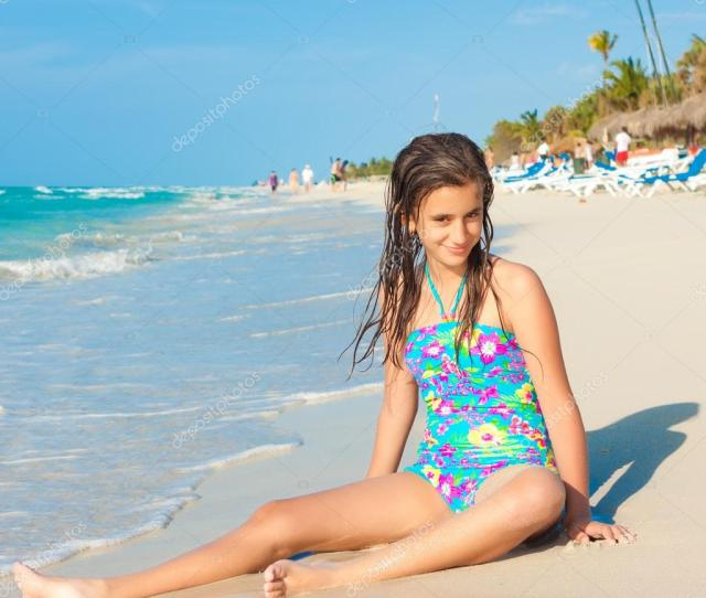 Cute Hispanic Teen Playing With The Waves On A Beautiful Beach In Cuba Photo By