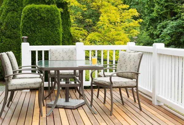 outdoor furniture on cedar wood patio during nice day stock images page everypixel