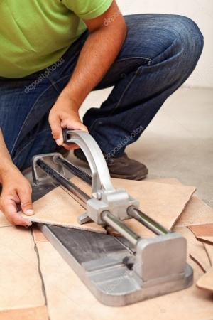 Worker cutting ceramic floor tiles     Stock Photo      lightkeeper  34771767 Worker cutting ceramic floor tiles     Stock Photo