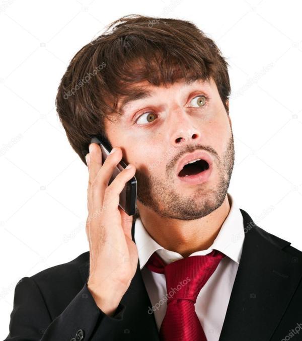 Красивый молодой деловой человек на телефоне ...