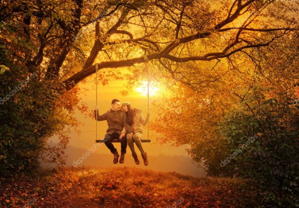 Romantic couple swing in the autumn park — Stock Photo ...