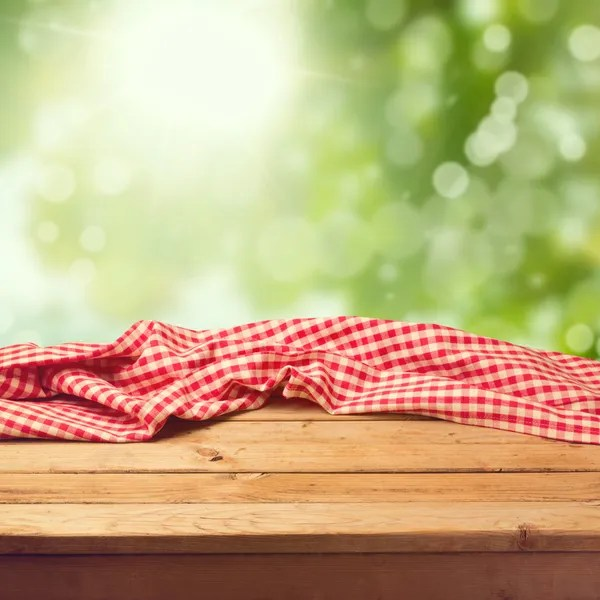 Deck Table Over Garden Bokeh Background Stock Photo
