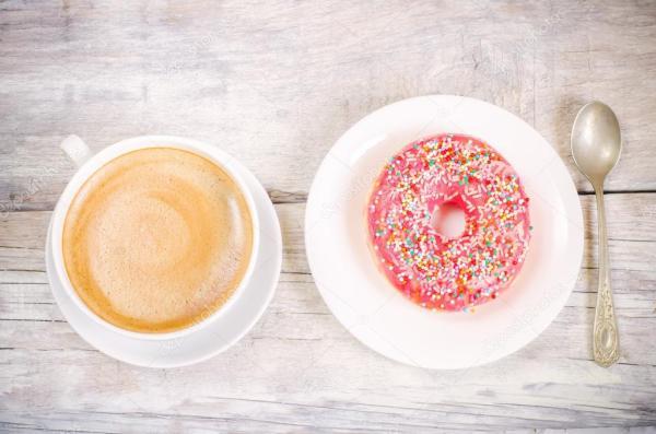 Пончики и кофе — Стоковое фото © nata_vkusidey #48058259