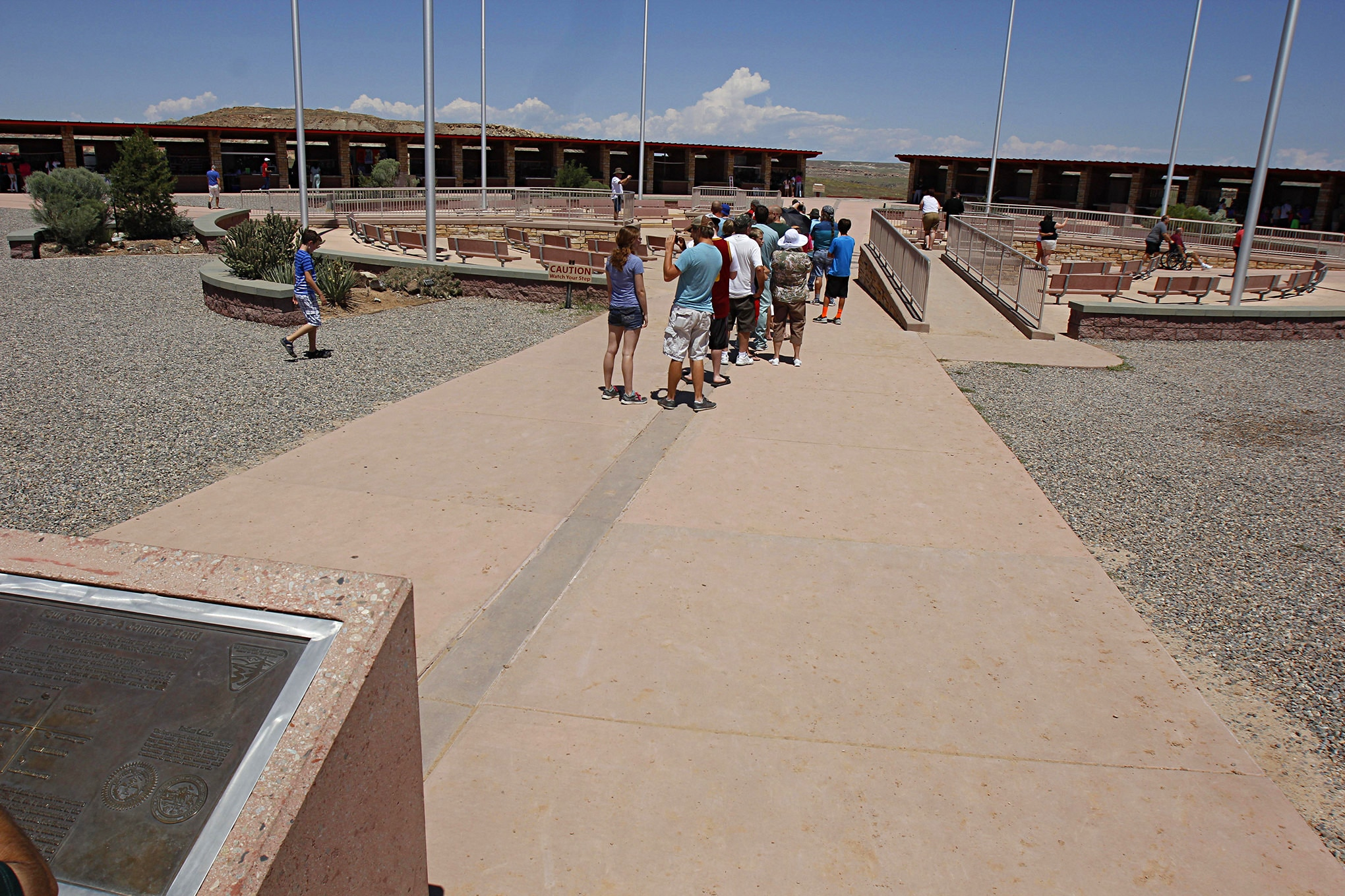 The Four Corners Monument is the one place in the country where you can stand in four states at one time. It's where the borders of Colorado, New Mexico, Arizona, and Utah meet, and people line up to have their pictures taken on the marker where all four states meet.