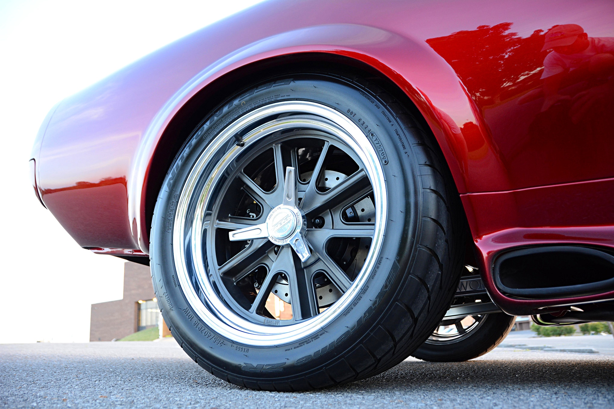 American Racing Shelby wheels are sized at 17x8 and 18x11 inches and wear a set of Nitto 555 tires. Hidden behind the spokes are Wilwood disc brakes, which use 14-inch rotors and a combination of six-piston (front) and four-piston (rear) calipers for big-time braking power.