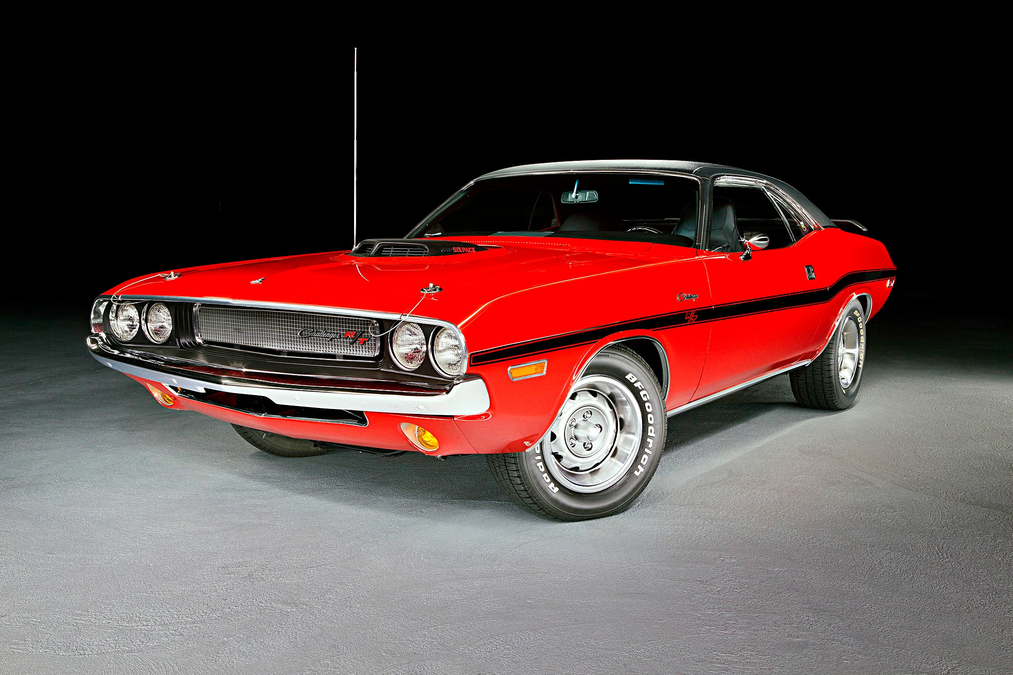 This looks like a fantastically restored 1970 Rally Red Challenger, and it is. This does not look like an 11-second car, but it is. John Kennedy has one of the cleanest, nicest, highest caliber, and fastest stock-looking Challengers in the country.