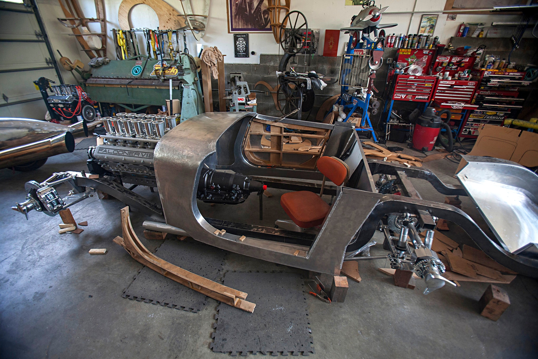 When we stopped by Randy's shop in the summer of 2015 the engine and chassis were mocked up and the body tub and doors were under construction. The door frames and the tub are built using 1/8-inch 3003 aluminum that Randy hand-formed and TIG-welded over fiberboard bucks. No annealing was necessary.