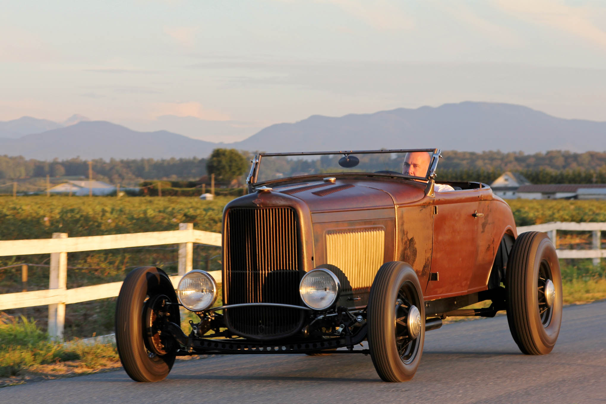 The patchy paintjob, low slung Deuce headlight bar, and angled windshield, chopped 3-1/2 inches, contribute to the roadster's sinister attitude. The '30 body, from Washington State, proved in decent shape, simply requiring lower patch panels and fresh floor pans.