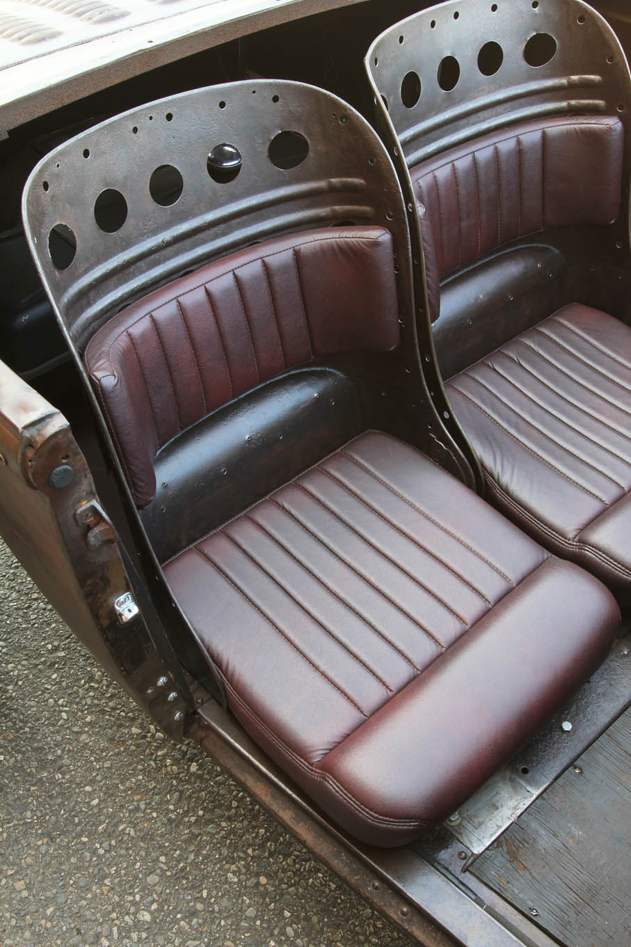 We bet only a few readers will recognize the low-mounted seats as those out of a '35 Chevy sedan. Or, what's left of them when you remove the padding. Bolsters dressed with leather insure an acceptable level of comfort.