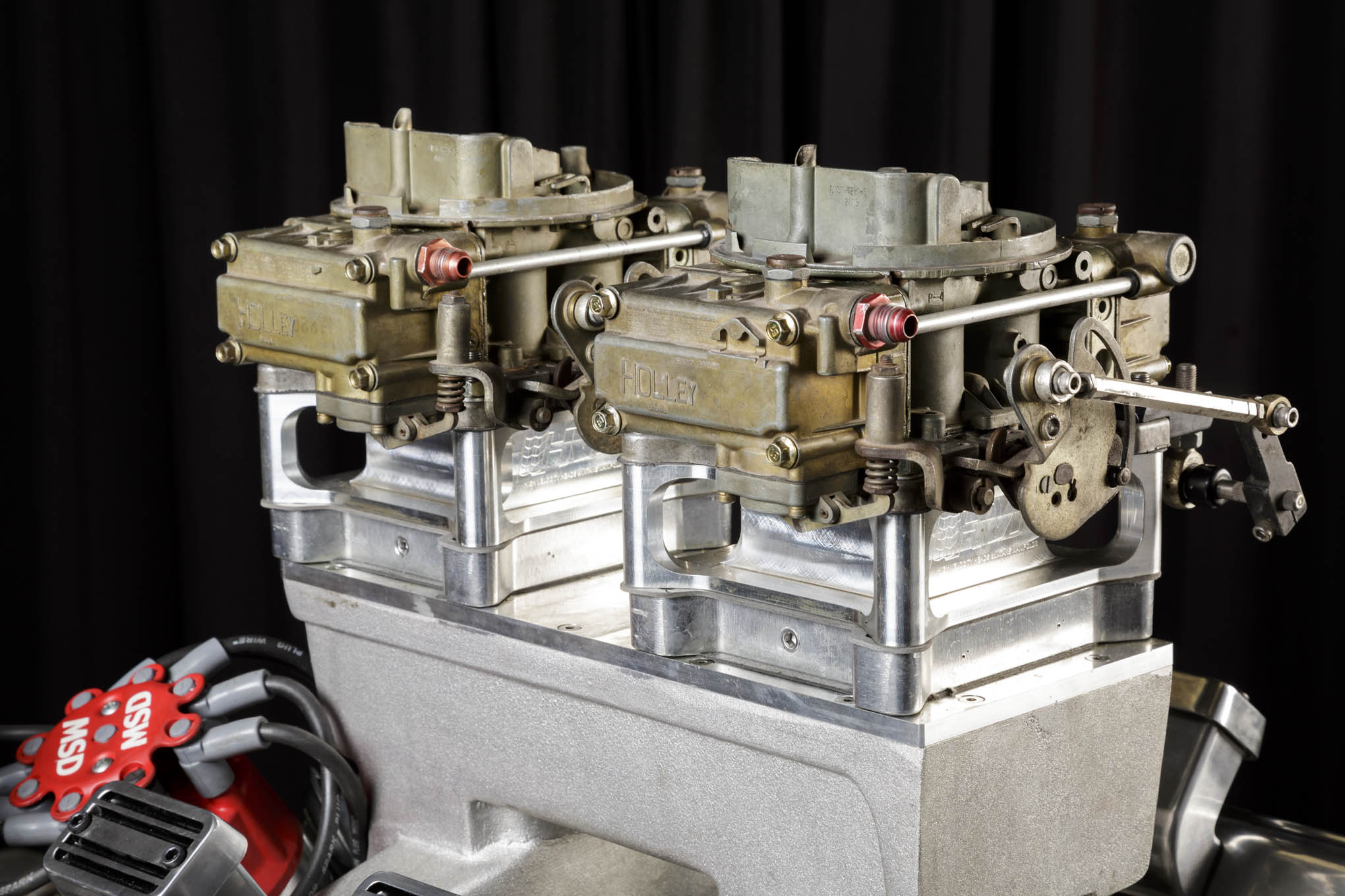 """Believe it or not, it was a set of old, 660cfm Holley center-squirters that were the magic ingredient for power. """"We were having trouble with carburetors, so we grabbed a pair of 40-year-old center-squirters. We just stuck 'em on there and Bingo,"""" said Eaton. While originally mounted inline, the carbs were turned sideways to facilitate jet changes during competition."""