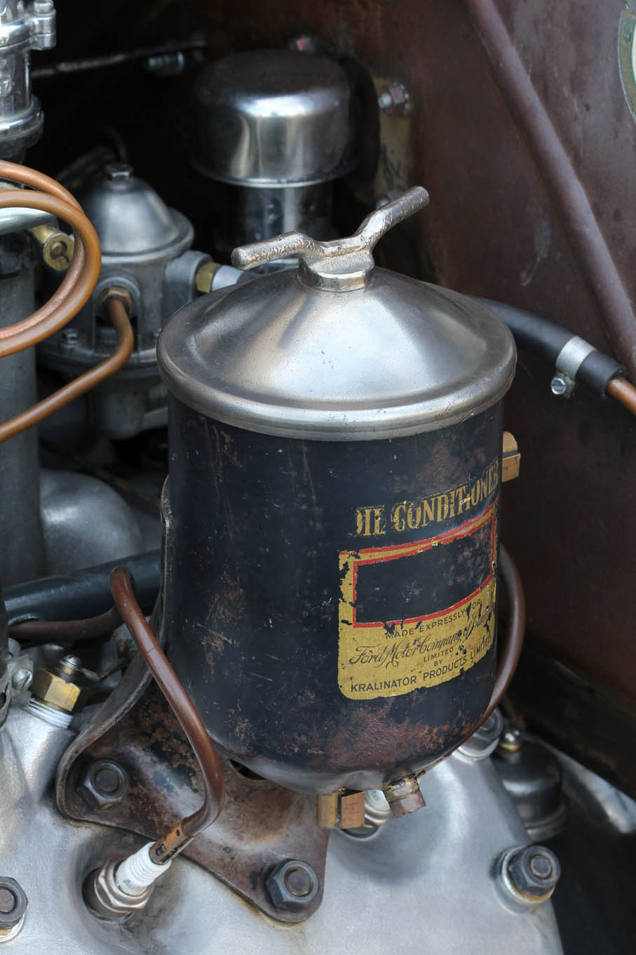 Steve nickel plated the top of the vintage oil filter (known as a Kralinator Oil Conditioner) in, of all things, a Crock Pot. The process involved vinegar, some guitar strings, and a 6-volt battery!