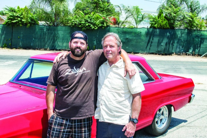 "Car owner Sean Price (left) and his pops, Tom, were blown away by the Nova's performance gains. ""Thanks, HOT ROD and Rollings!"""