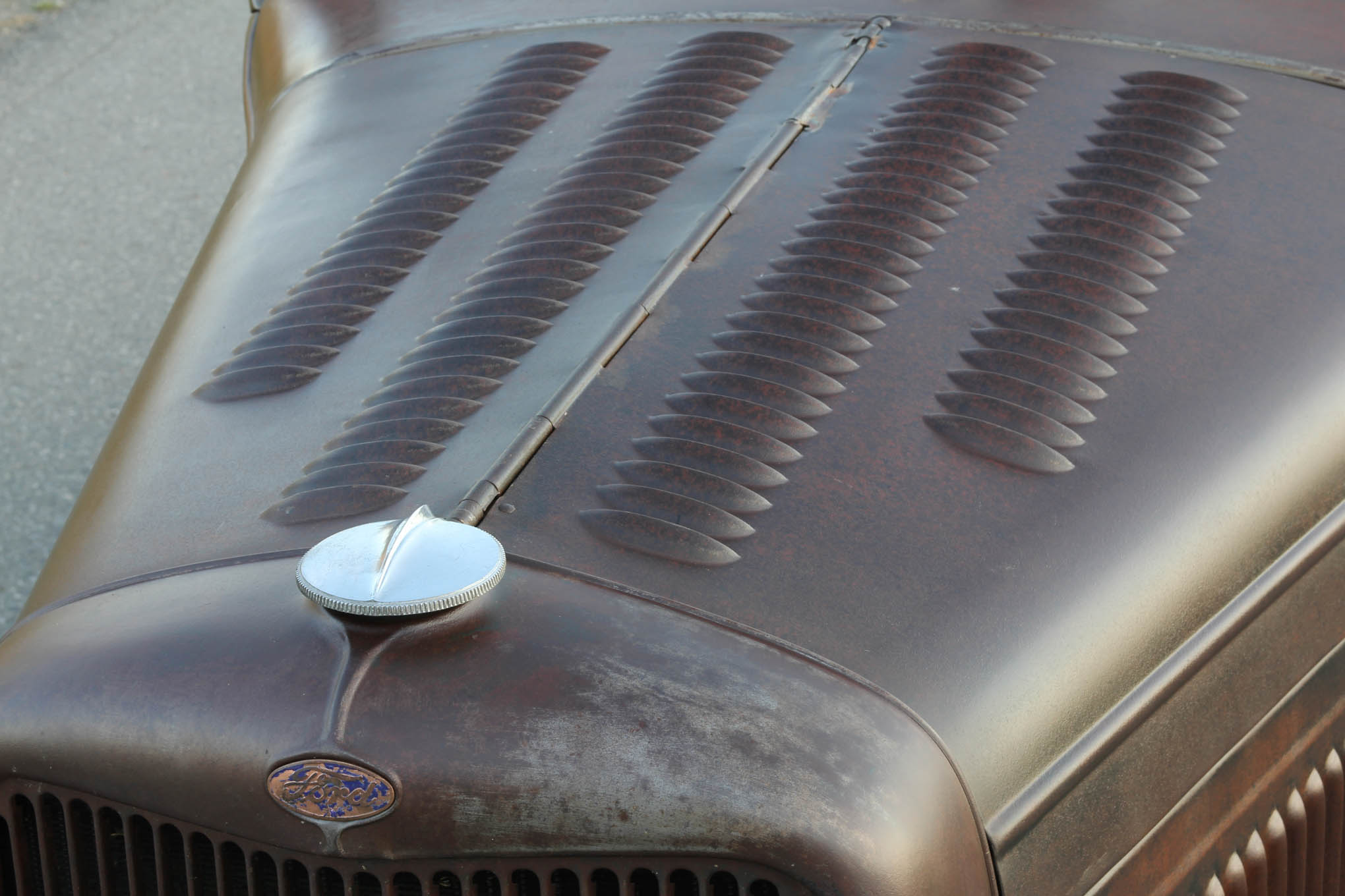 A few dozen louvers adorn both the hood and decklid. You can recognize the '32 shell as a commercial unit, as it lacks the fancy chrome-plated die-casting that joins the radiator cap to the Ford script. The grille shell came from California, while Steve found the complete hood in British Columbia.