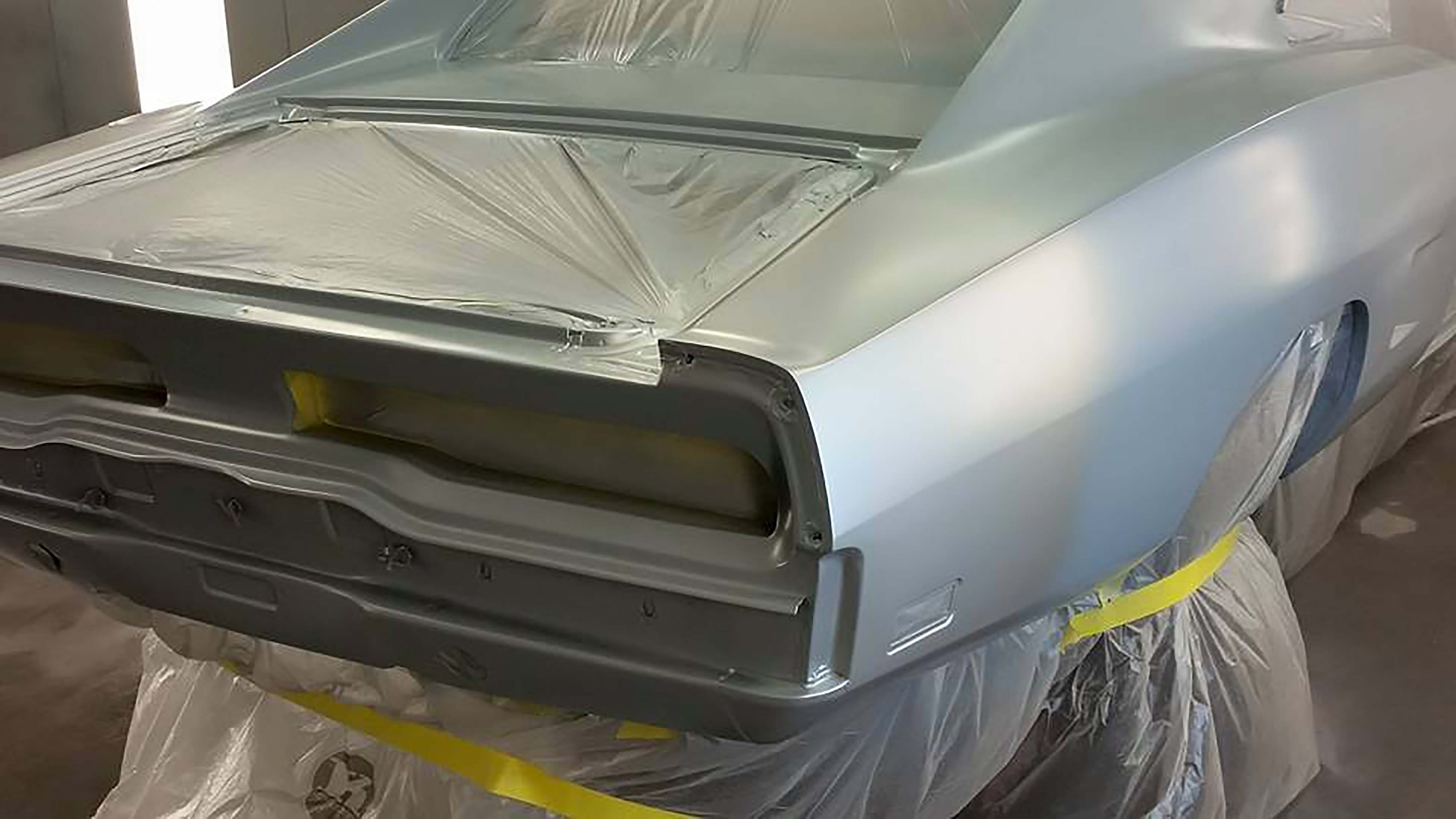 Instead of going the traditional decal route for the butt stripe, we opted to paint one on the car. That meant more work but it would also give a seamless finish to the back of the car. The very first step in the whole painting process (once the car was masked properly) was to lay down several coats of our butt stripe color, a not-too-blingy silver pearl.