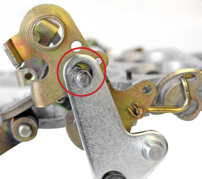 The throttle-cable ball stud that also picked up the TV-cable adapter bracket's top mounting hole was too small. The TV bracket couldn't stay centered, causing the cable to fall out of adjustment when the linkage rotated.