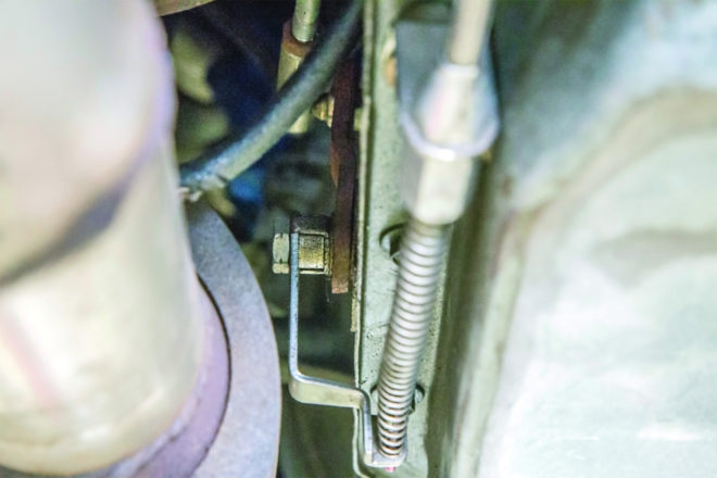 Unfortunately, even with the correct carb bracket and carb linkage at-idle cable adjustment setting, there remained insufficient travel at the trans end to achieve full valve compression at WOT with Zimmer's original aftermarket TV cable-to-trans adapter bracket (shown).