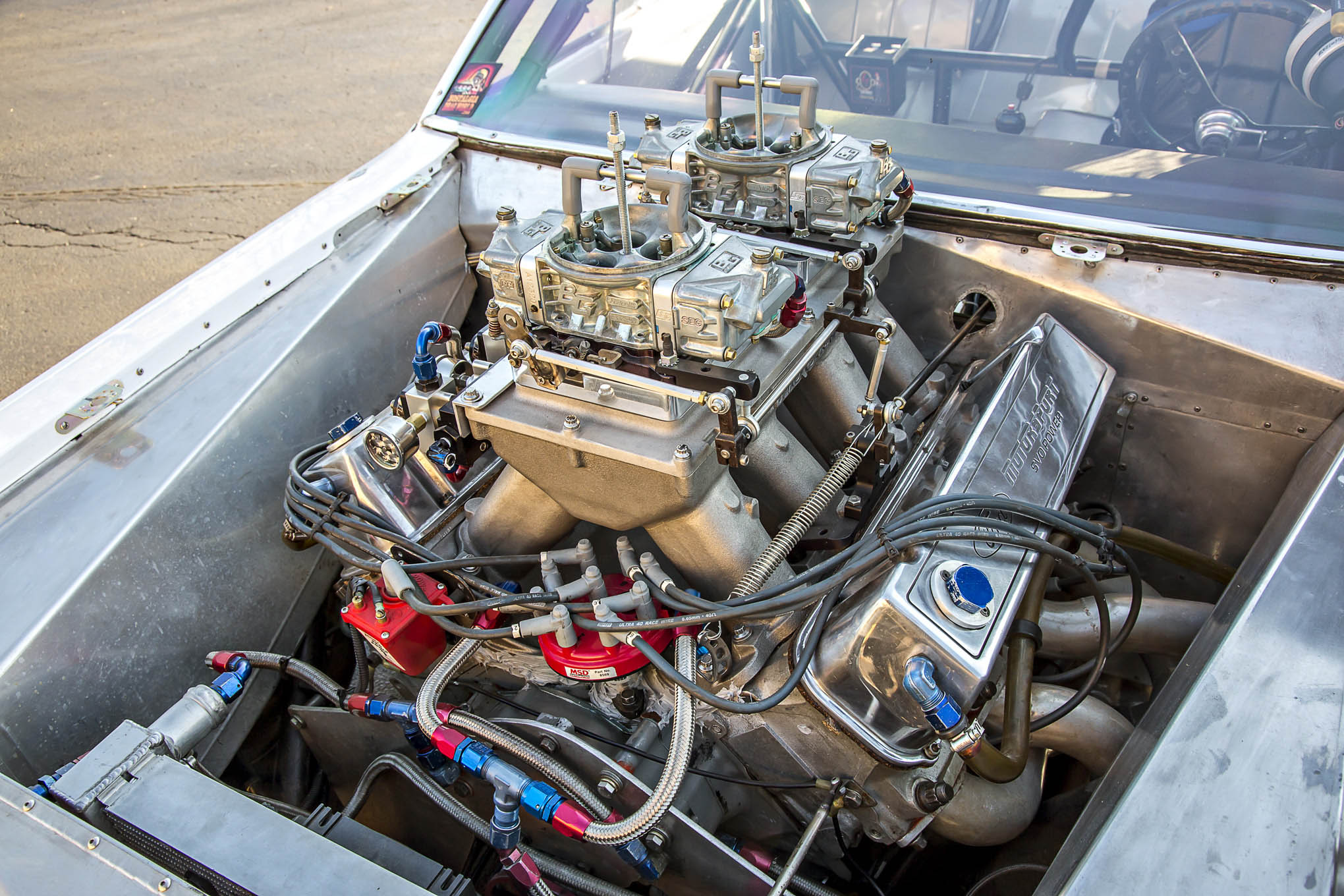 "Here's what we mean by ""mountain motor majesty."" Dual carbs on a cast hi-rise, proudly displaying all of its 500 cubic inches right in your face. From the looks of those headers, it looks like you could stick your arm into the head ports!"
