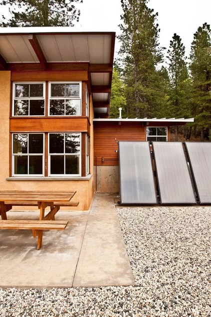 rustic exterior by Arkin Tilt Architects