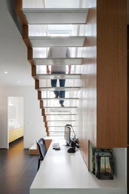 modern staircase by arbejazz architects studio ltd.
