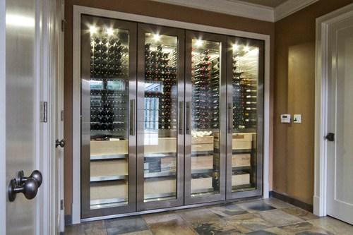 modern wine cellar by Vin de Garde Wine Cellars Inc