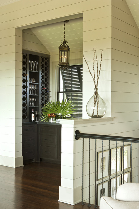 tropical wine cellar by BROWN MEIHAUS CONSTRUCTION CO.
