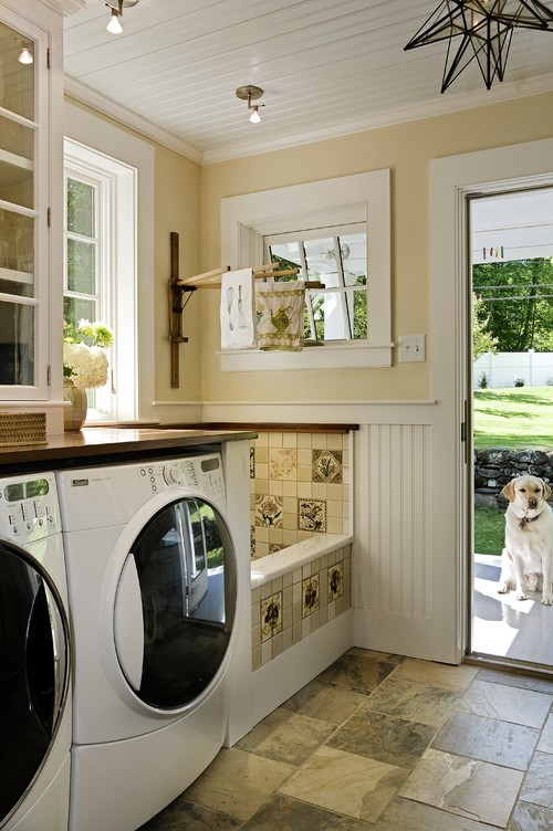 Stunning laundry room, mud room & dog shower traditional laundry room