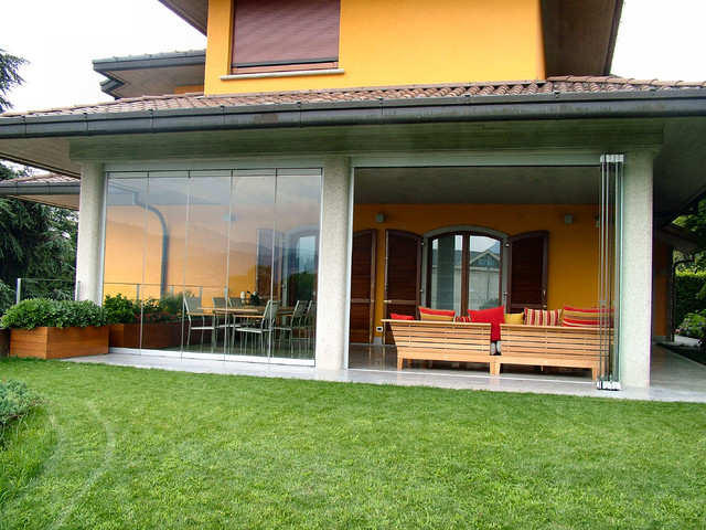 Patio closed off with folding glass doors, water and airproof on Closed Patio Design id=43192