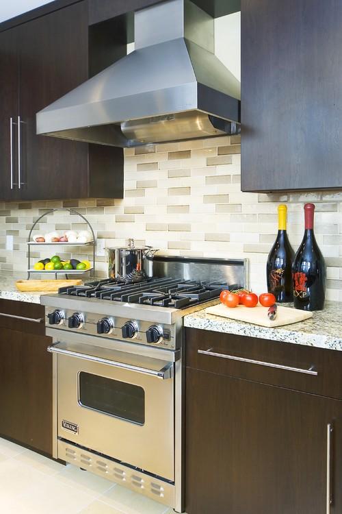 Backsplash with cherry cabinets & dark grey granite counter on Backsplash With Dark Granite  id=76472