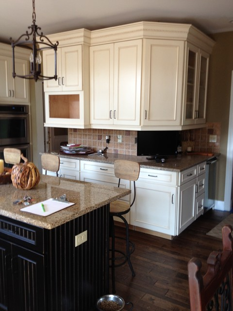 Schuler Cabinets In White Chocolate MainHeirloom Black Island In Knotty Alder Traditional