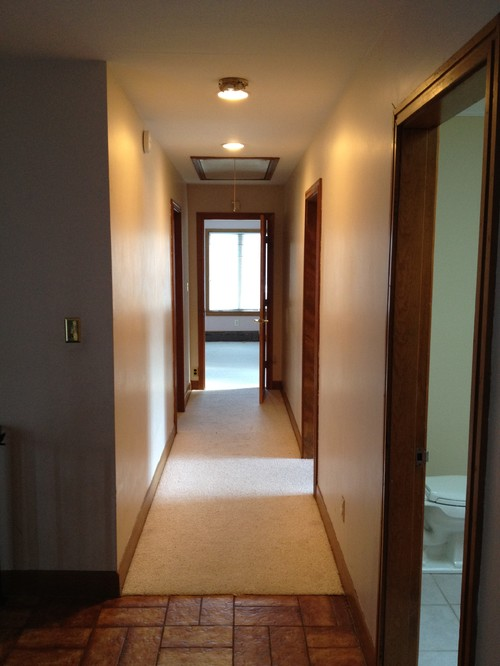 Laying Hardwood In Hallway And Into Bedrooms