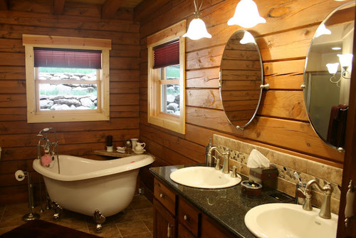 wood paneled family bathroom with claw foot tub