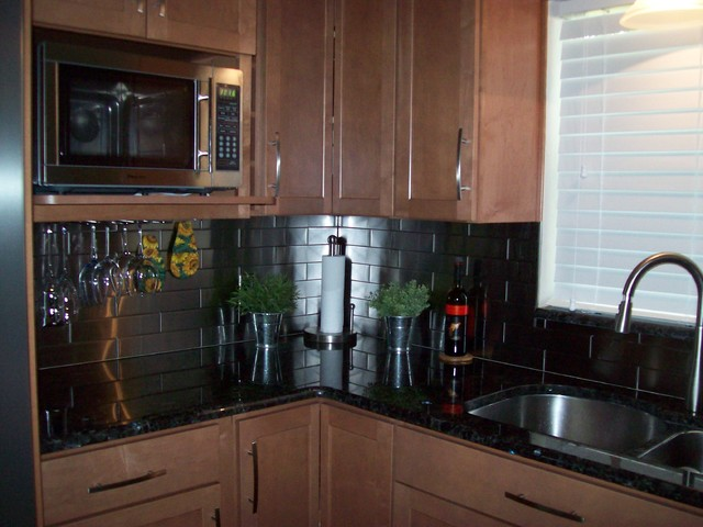 Remodeled kitchen with stainless steel backsplash and ... on Modern Kitchen Backsplash With Maple Cabinets  id=11940
