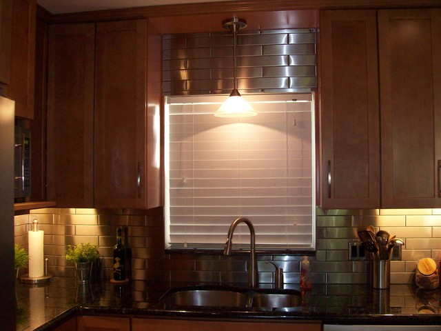 Remodeled kitchen with stainless steel backsplash and ... on Modern Kitchen Backsplash With Maple Cabinets  id=66372