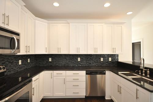 Black pearl granite countertops with glass mosaic ... on Backsplash Black Granite Countertops  id=94057