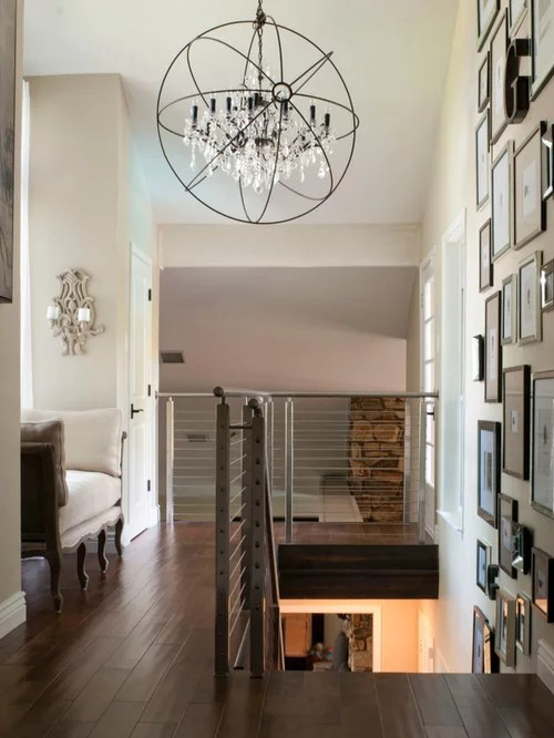 Example Of A Transitional Dark Wood Floor And Brown Hallway Design In Dallas With White