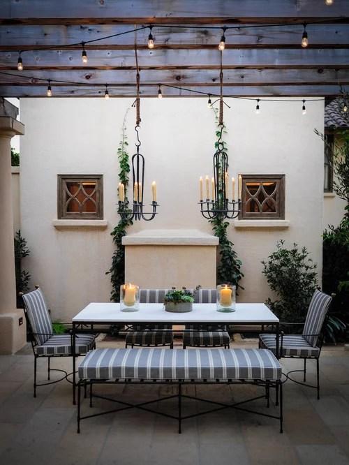 Example Of A Tuscan Patio Design In Santa Barbara With Pergola
