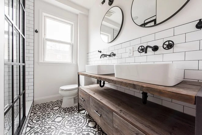 Industrial Bathroom by Schmauder Group