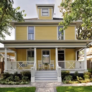 American Foursquare Ideas   Photos   Houzz Inspiration for a timeless yellow wood exterior home remodel in Houston