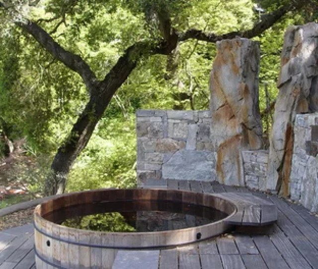 Example Of A Mid Sized Trendy Backyard Gravel And Round Aboveground Hot Tub Design In