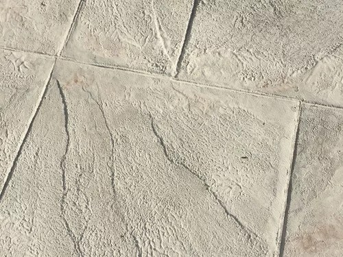 botched stamped concrete patio job