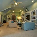 Family Living Space With Coffered Ceilings And Stone Fireplace
