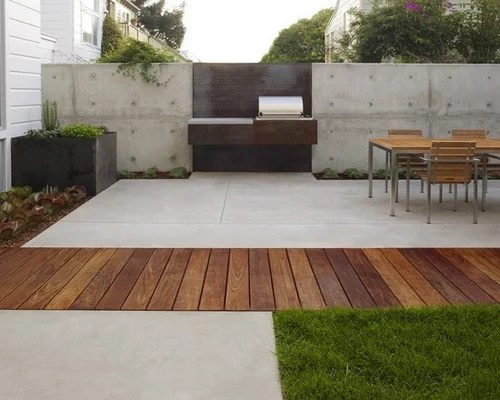 wood decking next to concrete pad how