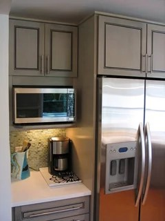 microwave in an upper or lower cabinet