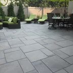 Pea Gravel Patio With Stacked Stone Wall Contemporary