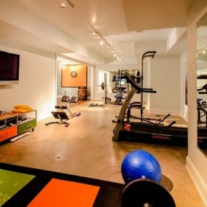 Basement Gym   Houzz Example of a trendy concrete floor and orange floor multiuse home gym  design in Atlanta
